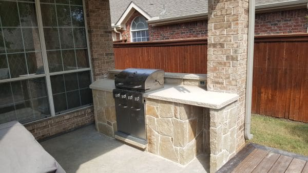 backyard bbq in stone patio