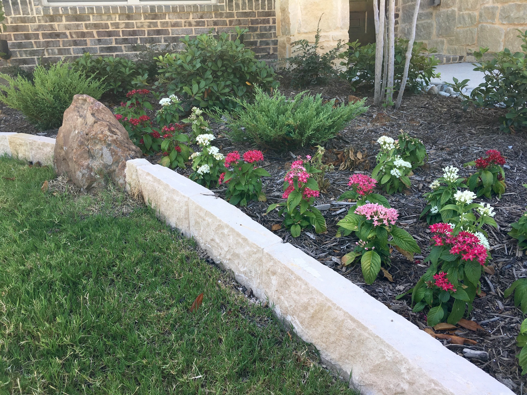 flower garden stone rock border new mulch
