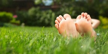 feet on grass front lawn