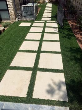 pavers in synthetic grass